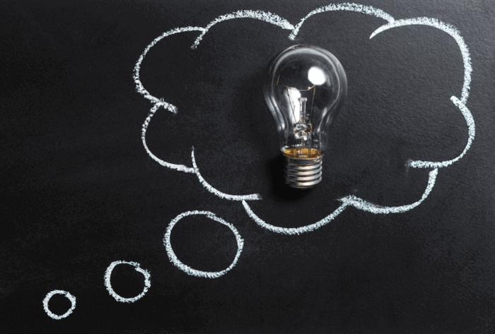 Light bulb in a chalkboard thought bubble